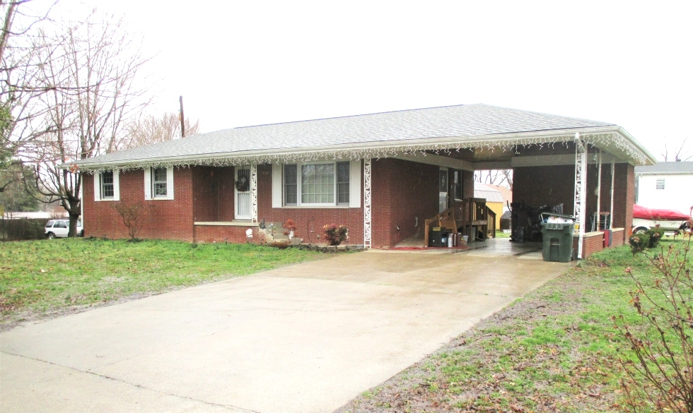 SOLD! REDUCED Brick home with three bedrooms, bath and half, living room, eat-in-kitchen, single carport(attached).
